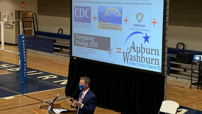 Auburn-Washburn Unified School District 437 superintendent Scott McWilliams speaks during the school board meeting Monday evening in the Washburn Rural High School gym.