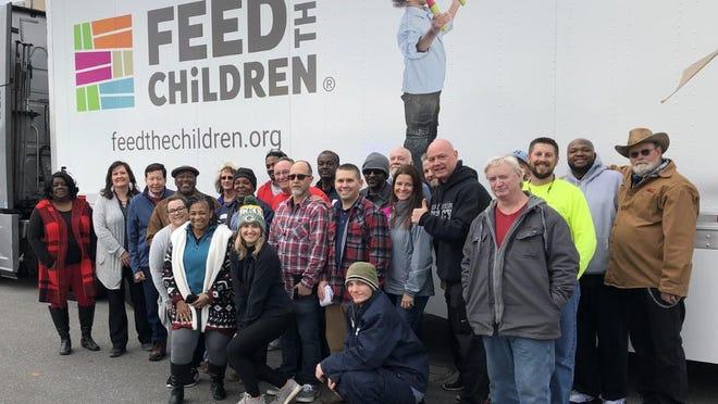 Feed the Children volunteers in 2019 help to feed members of their community.