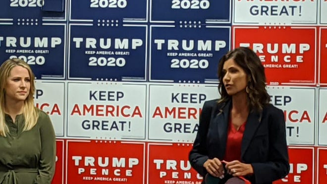 South Dakota Gov. Kristi Noem, right, speaks to more than 100 Tuesday morning at a Women for Trump meet-up at the president's Ohio campaign headquarters in Westerville. Erin Perrine, left, director of press communications for the Trump campaign, spoke earlier.