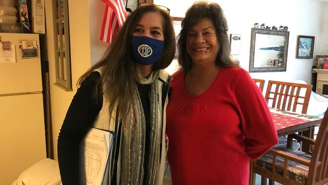 MCOP Executive Director Stephanie Kasprzak (left) and Melanie Counterman of Luna Pier are pictured. Counterman was among the senior citizens who received one of the gift bag packages.