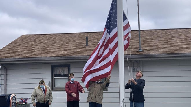 A detail from the Veterans of Foreign Wars Leonard T. Simmons Post 5191 in Waldron raises the nation's colors during the 2020 Veteran's Day Ceremony at the Leighr A. Wright American Legion Post 53 in Hillsdale Wednesday.