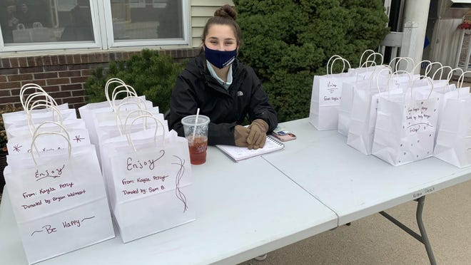"""Waldron senior Kayle Percy awaits the arrival of area youth Saturday for her second round of """"Snack Me"""" service."""