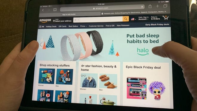 Several shoppers are turning to e-commerce sites to complete their holiday shopping from home and socially distance from the anticipated crowds at local retailers in order to complete their holiday shopping.