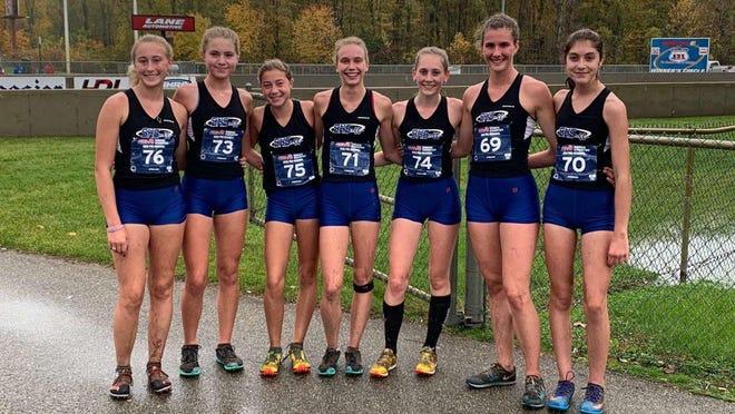 The Saugatuck girls cross country team won the pre-regional meet on Friday.