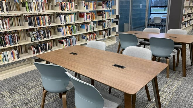 The expansion at Herrick District Library's north branch doubled the location's square footage and added a meeting room, study rooms, and an early literacy play area -- in addition to expanding the branch's seating and work space.