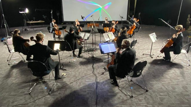 Members of Lansing Symphony Orchestra participate in a socially distant practice.