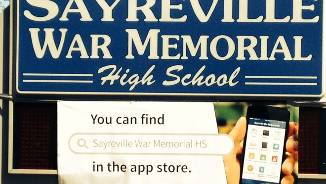 A sign at the entrance of the Sayreville War Memorial High School highlights the school's new app.