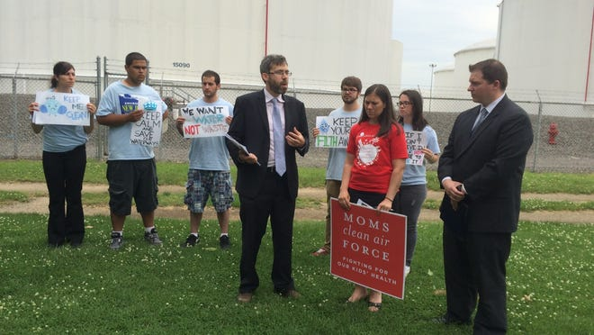 Doug O'Malley (center) with members of his Environment New Jersey staff Thursday, discusses the findings of a report that found the Paulsboro Refinery was the third-worst water polluter in the state.