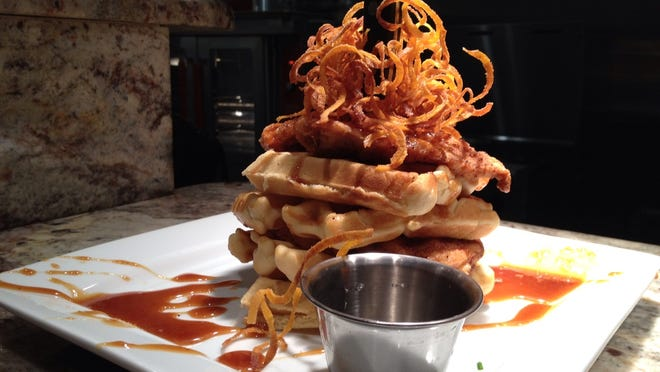 Chicken and waffles with buttermilk-caramel sauce from Fancy's Southern Cafe.