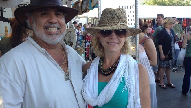 Bob and Mary Broussard do Festival hats right.
