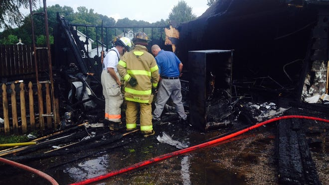 Robert and Samantha Parton lost almost everything they own today in a garage fire at 462 Pearl St.