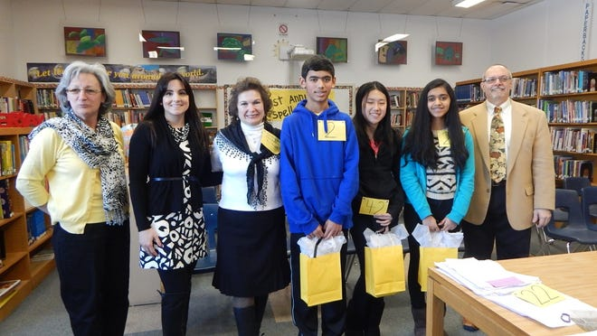 Pictured (left to right) are: Judge Nancy McMahon, Judge Antonia Hernandez, Spelling Bee Coordinator Joanne Hirsch, Spelling Bee winner Ashwin Agnihotri, third place winner Theresa Zhang, runner-up Shreya Menon and Pronouncer Tony Maccarella.
