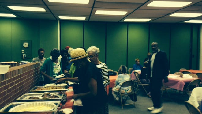 Senior citizens put food on their plates Monday at the Unity Community Center. The center unveiled its senior programming with a breakfast with Mayor Dennis Tyler followed by a resource fair.