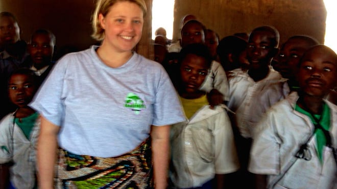 Kimberly Cofer, a former La Quinta resident, with students in Itumba Hill, Tanzania.