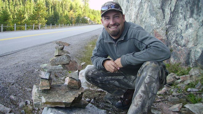 Columnist Doug Berdan poses with his Inukshuk
