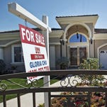 A for sale sign is posted on a home in Monterey Park, Calif.