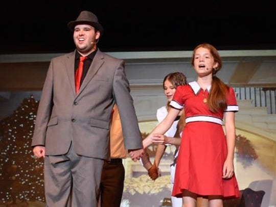 Ryley Rose (as Daddy Warbucks) and Natalie Magers (as
