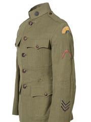 This tunic belonged to a soldier in the 165th Infantry