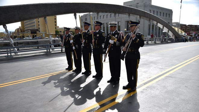 A military color guard sets up to welcome Reno's new Virginia Street Bridge on Tuesday morning, April 12 in downtown Reno.