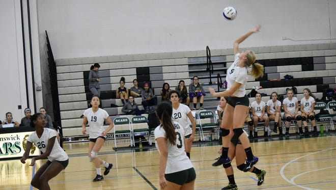The East Brunswick girls volleyball team won its second-straight GMC Tournament title with a 2-0 victory over Colonia on Saturday.
