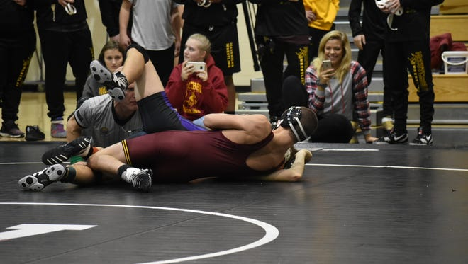 Shayla Phillips watches her brother, Spencer, compete earlier this season. The McCutcheon wrestling manager passed away on Dec. 14.