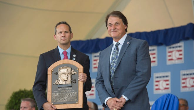Jul 27, 2014; Cooperstown, NY, USA; Hall of Fame president Jeff Idelson presents the Hall of Fame plaque to inductee Tony La Russa during the class of 2014 national baseball Hall of Fame induction ceremony at National Baseball Hall of Fame.