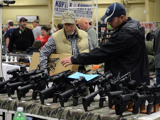 Larry Wykle, left, and Caleb Robertson from Brevard, check out some guns on display during the Gun and Knife Show at the Western North Carolina Agricultural Center in 2015.