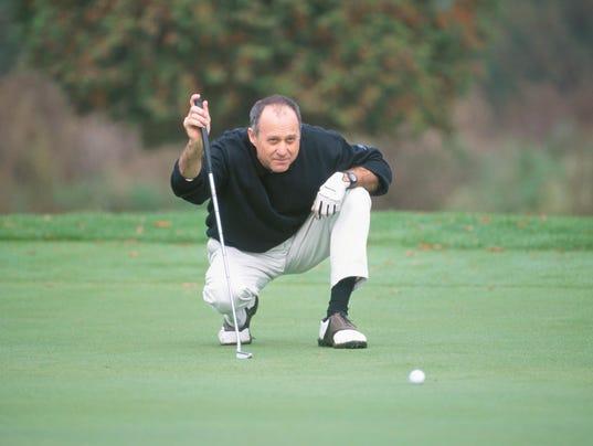 Golfer lining up shot