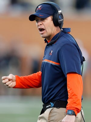 Virginia paid Bronco Mendenhall and his staff more per win than any public school this season, but school officials could have expected that.