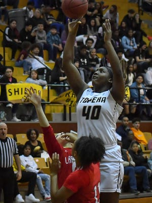 NiJaree Canady and her Topeka High teammates will finally open the 2020-21 season Friday night at home against Topeka West. Canady and the Trojans are coming off a 23-0 season last year that saw their quest for a state title end when the state tournaments were canceled after the quarterfinals.