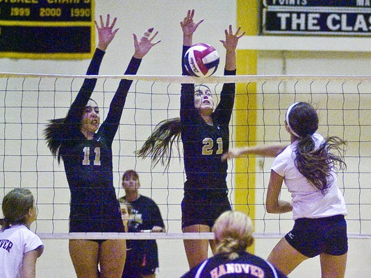 Delone Catholic's Cheyenne Atland, left, and Cambria Wierman, attempt to block the shot of Hanover's Shelby Barnes last season at Delone. All three are back for their teams. (GAMETIMEPA.COM -- FILE)