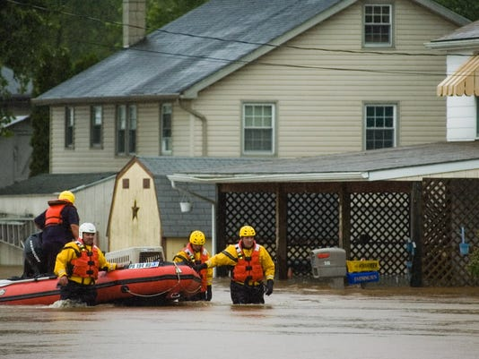 Homeowners along Conewago Drive in Reading Township, which receives frequent flooding, are among those who could benefit from the new plan. In this photo from 2011, crews rescue a dog from a flooded Conewago Drive home.