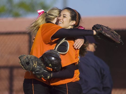 Central York's Kelsey Shifflett, left, embraces catcher Ally Dziwis after their 2-0 win over Delone Catholic in the YAIAA championship game on Monday night at New Oxford High School. (GAMETIMEPA.COM -- SHANE DUNLAP)
