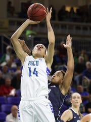 FGCU's Whitney Knight is defended by North Florida's Amber Robinson during a game at Alico Arena on Wednesday night.