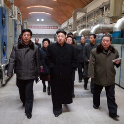 An undated picture made available on March 12, 2014 by the North Korean Central News Agency shows North Korean leader Kim Jong-un (C) attending a shooting practice at a military academy in Pyongyang, North Korea.