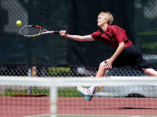Spenser Smith of Roosevelt chases after a ball as he
