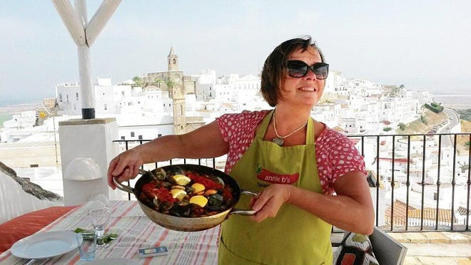 Southern Spain cooking expert Annie Manson is shown in a recent photo on the rooftop kitchen of her cooking school in Jerez de la Frontera.