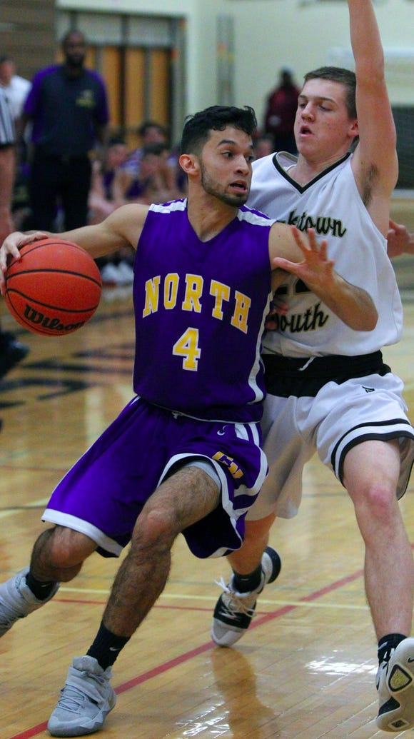 Clarkstown North's Michael Louzada is pressured by