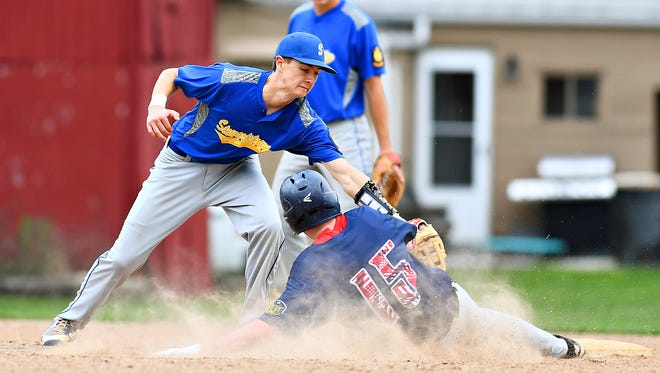 Stewartstown's Joey Thomas, left, reaches to tag out Pleasureville's Michael Nizinski as he safely slides into second during York-Adams American Legion baseball action in Springettsbury Township, Wednesday, June 27, 2018. Dawn J. Sagert photo