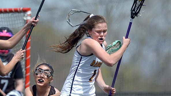 Spencerport's Erin Coykendall, right, loses her mask