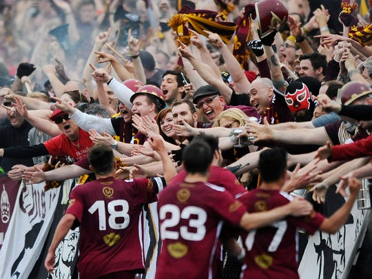 Fans cheer the DCFC goal during the 1-1 draw with AFC Ann Arbor last Friday at Keyworth Stadium.