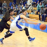 Carlsbad senior guard Kloey Tiller comes up with a steal against Alamogordo senior guard Carina Baca in the fourth quarter Friday.