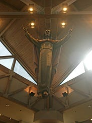 A suspended statue of Christ catches the eye at St.