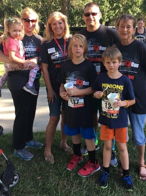 The Baraniak family, left to right, Winter, Laura,  Sharon Tyler, Executive Director of the Capitol Area Red Cross Chapter, Sean, his mother, Janet, and sons Thaddeus and Kai, participated in the 9th Annual Robin Lotane Hurricane 5K Run and 1 mile Fun Run/Walk.