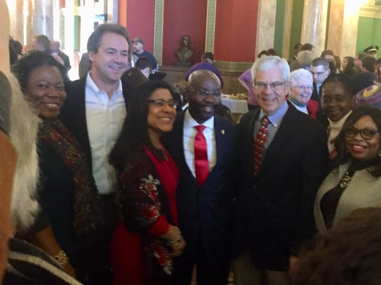 Wilmot Collins and his family pose with Gov. Steve Bullock and Lt. Gov. Mike Cooney after Tuesday's ceremonies in the Capitol rotunda.