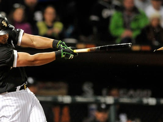 Chicago White Sox's Jose Abreu breaks his bat while hitting an RBI single during the third inning of a baseball game against the Kansas City Royals Monday, April 24, 2017, in Chicago. (AP Photo/Paul Beaty)