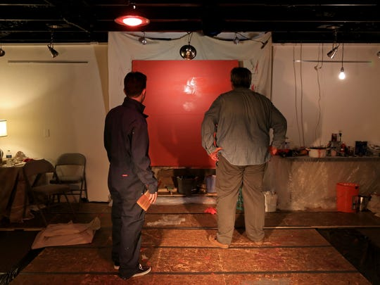 "Jesse Nepivoda, as Ken, and Varlo Davenport, as Mark Rothko, look at a painting in Rothko's studio during The Space Between Theatre Company's production of ""Red"" at the DiFiore Center in St. George."