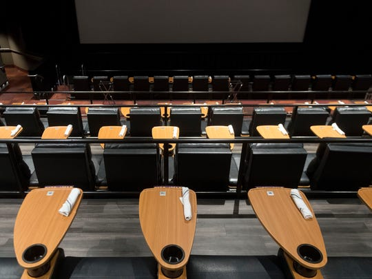 Regal's Cinebarre includes leather reclining seats and a table for dining and drinking.