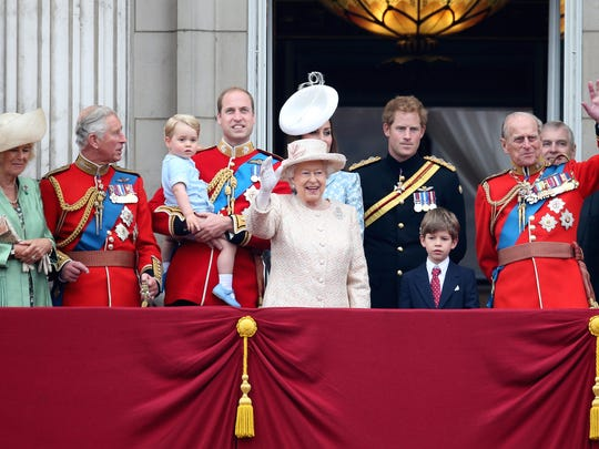 Queen Elizabeth II and Prince Philip wave to the crowds