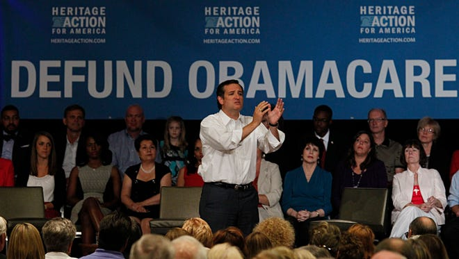 At an event sponsored by the conservative Heritage Foundation last month in Dallas, Sen. Ted Cruz speaks about the push to remove funding for the federal health care law.